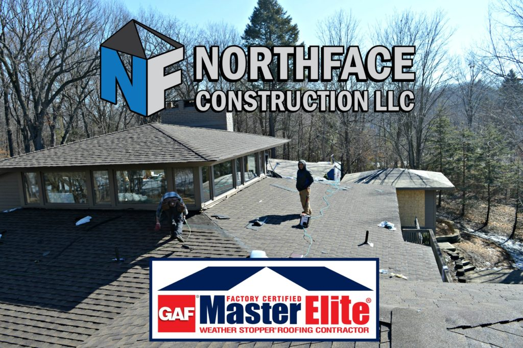 men working on gray roof Northface Construction